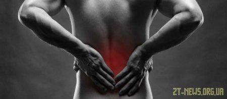 Біль у спині: звідки береться та що робити